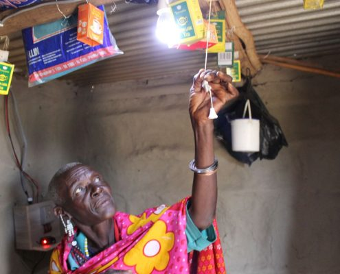 Turning on a Solar Powered Light in Tanzania